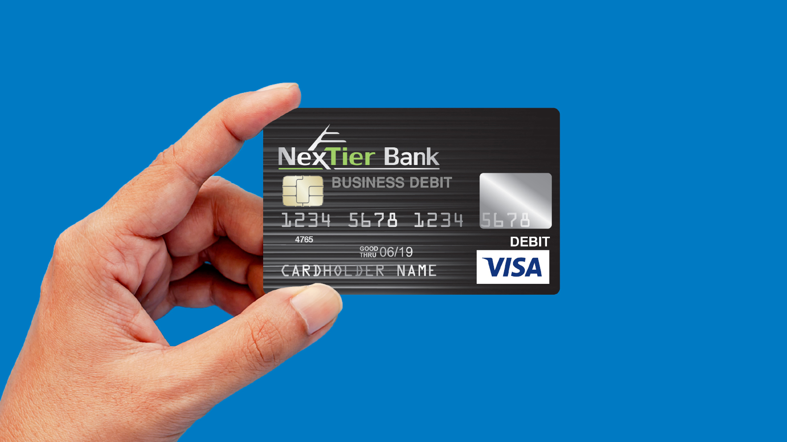 hand holding up NexTier business debit card.