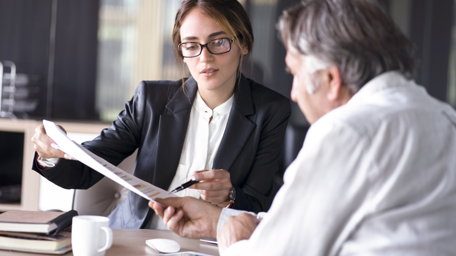 business woman showing documents to client