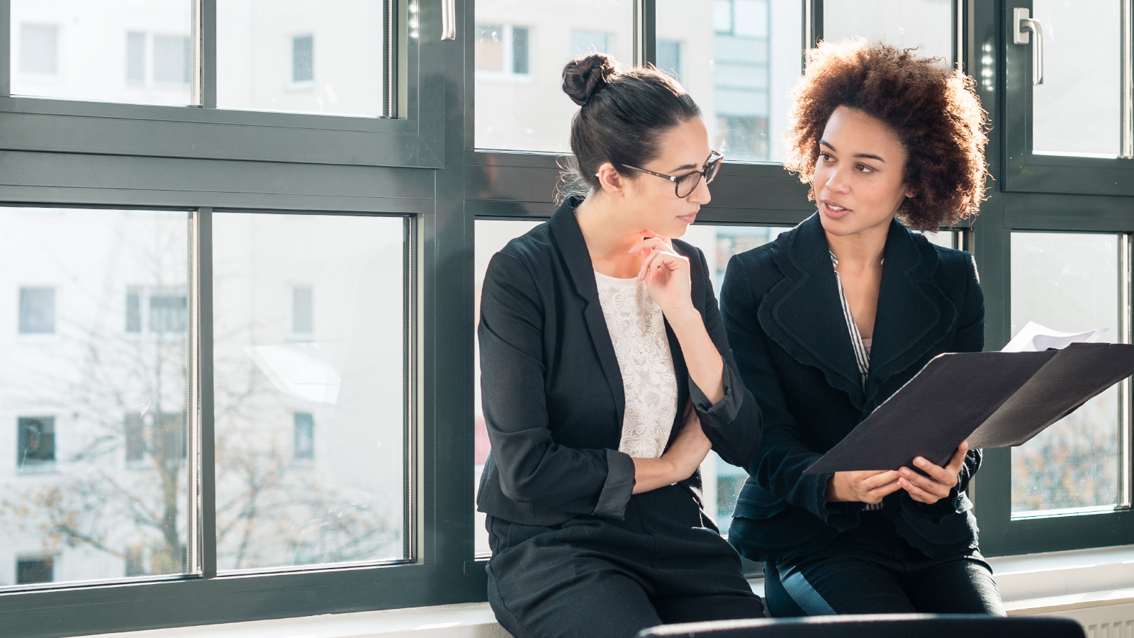 two business women discussing financials