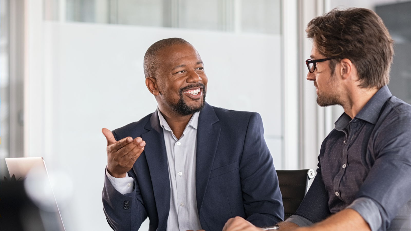 two business men discussing an account
