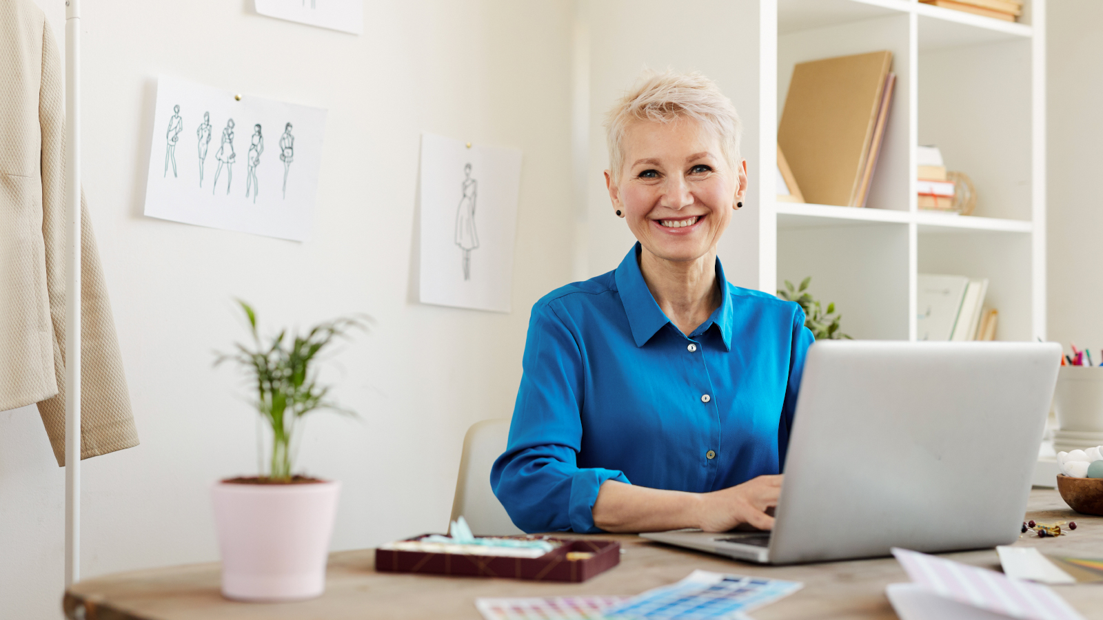 Woman working at desk on laptop